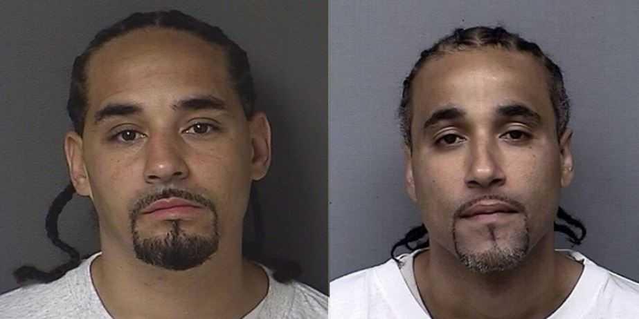 Невиновный Ричард Джонс - слева, Рик Амос - справа.