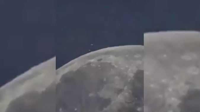 Над луной завис огромный НЛО и что-то сбросил.